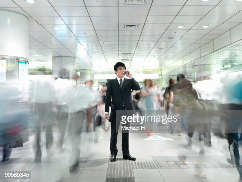 Businessman who calls in coming and going people : Stock Photo
