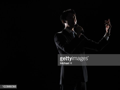 Businessman who delivers a fervent speech with mik : Stock Photo