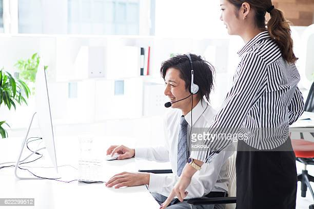 Businessman who is taught correspondence of call center to boss
