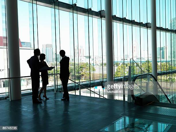 Businessman who makes arrangements in entrance.