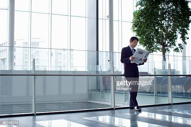 Businessman who reads newspaper.