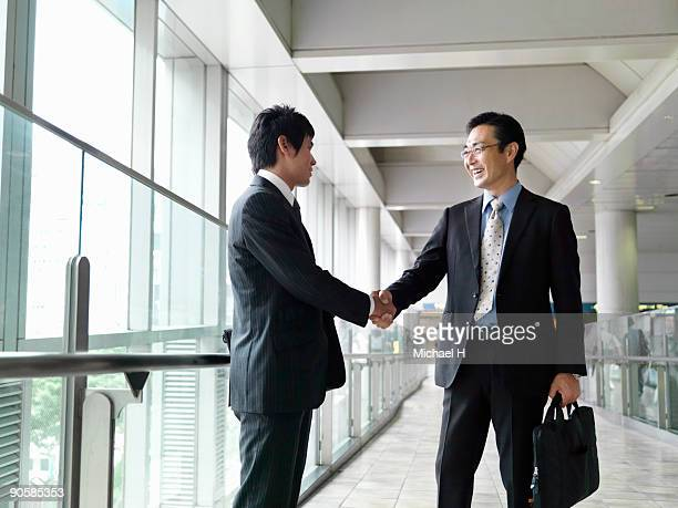Businessman who shakes hands with client