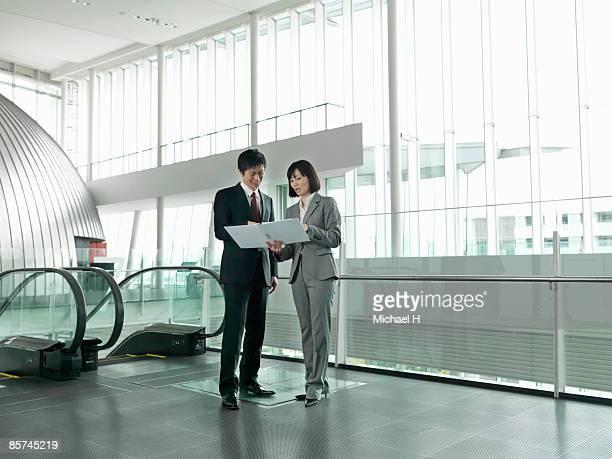 Businessman who talks in escalator hall