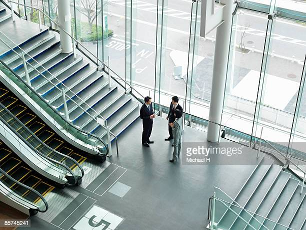 Businessman who talks in escalator hall