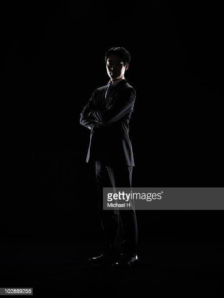 Businessman who unites arm and is standing