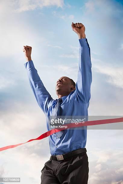 Businessman winning a race