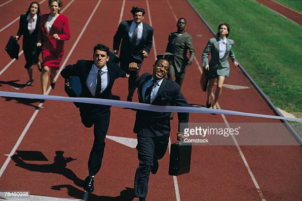 Businessman winning race against others