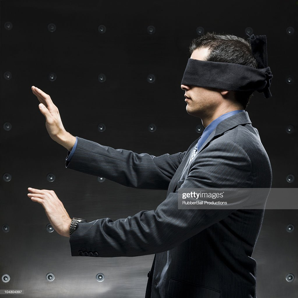 businessman with a blindfold on