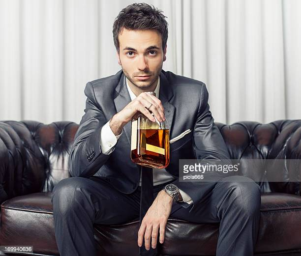 Businessman with a bottle of whisky