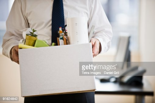 A businessman with a box full of desk stuff