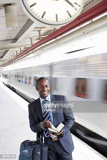 A businessman with a calendar at a train station Stockholm Sweden.