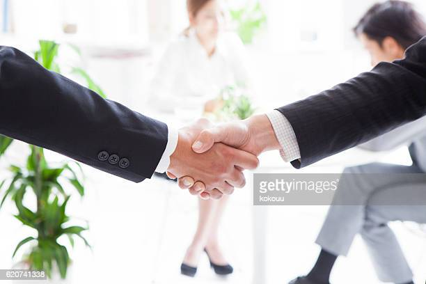 Businessman with a handshake at the office