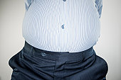 A businessman with a large belly