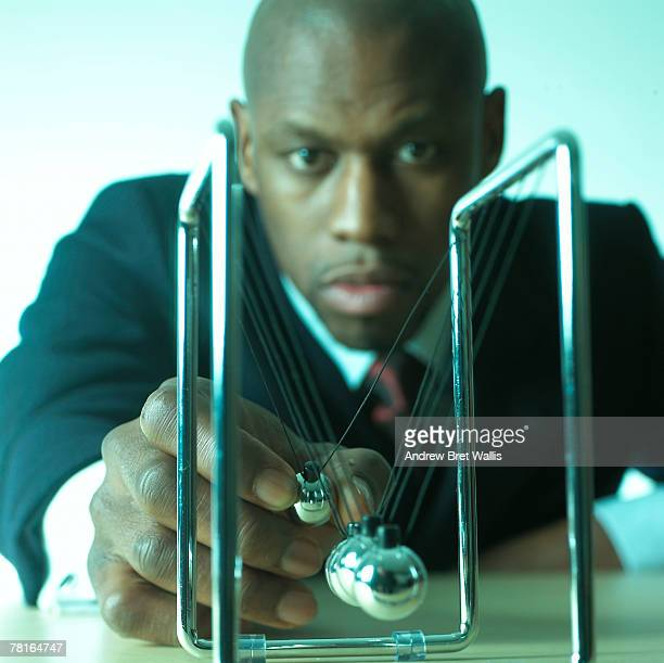 Businessman with a Newton's cradle
