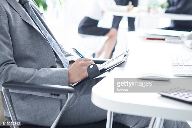 Businessman with a note in a notebook in the office