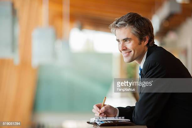 Businessman with a planner