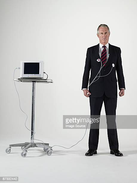 Businessman with a pulse trace machine