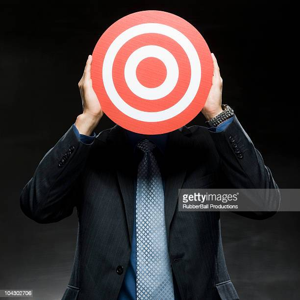 businessman with a target in front of his face