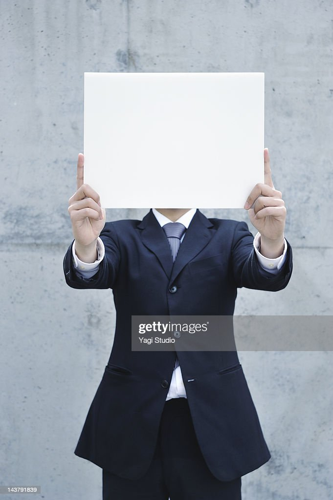 Businessman with a white board : Stock Photo