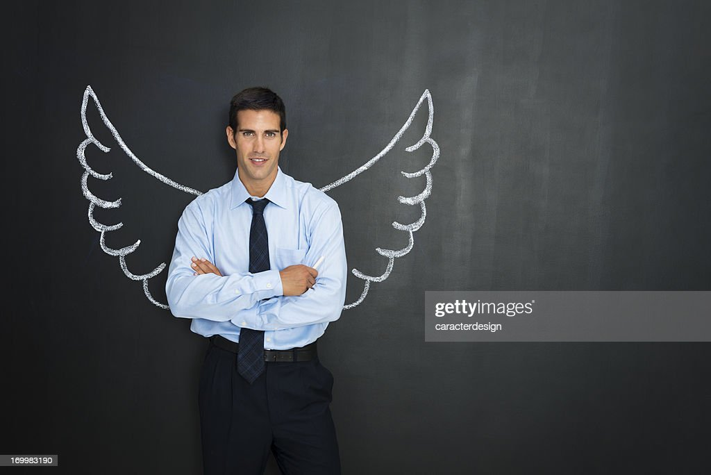 Businessman with angel wings