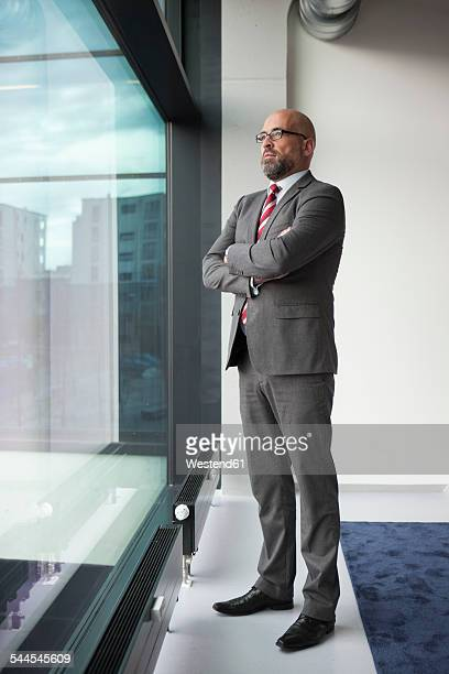 Businessman with arms crossed at the window