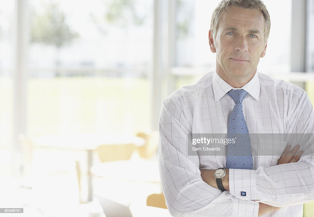 Businessman with arms crossed : Stock Photo