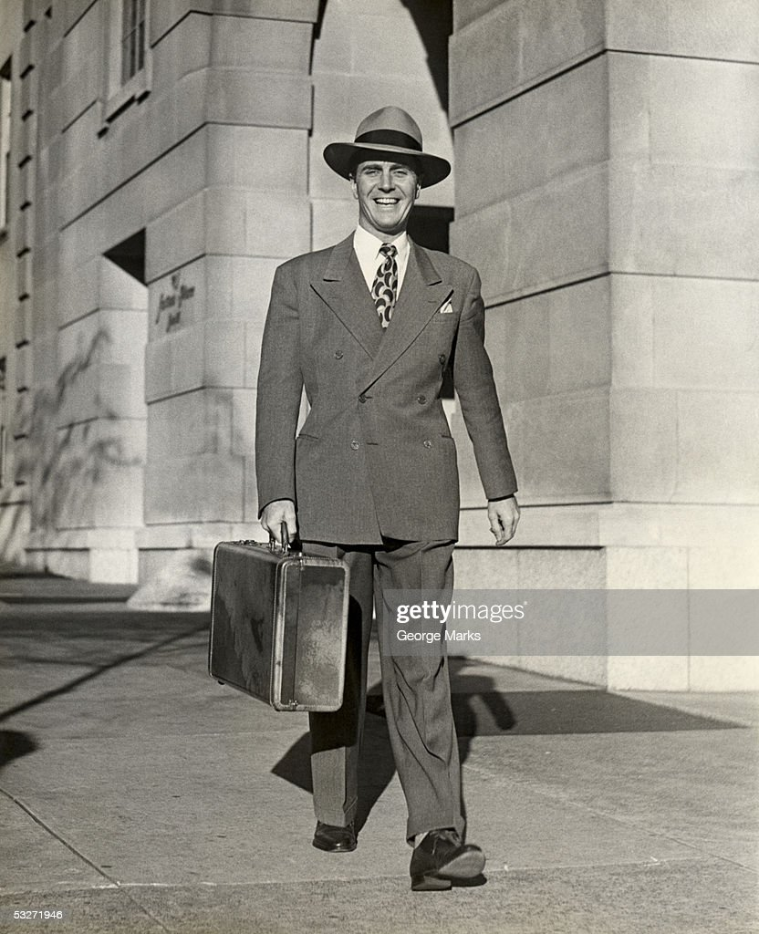 Businessman with attache case outdoors : Stock Photo