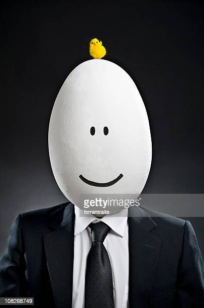 Businessman with Baby Chick on Egg Head