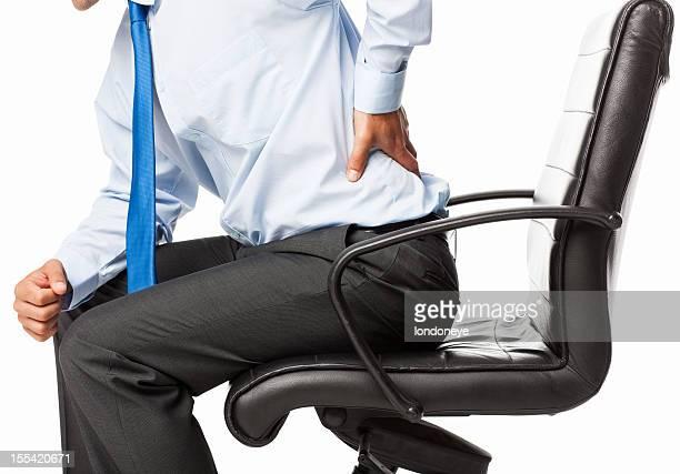 Geschäftsmann mit Rückenschmerzen-isoliert