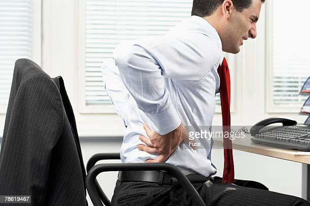 Businessman With Backache