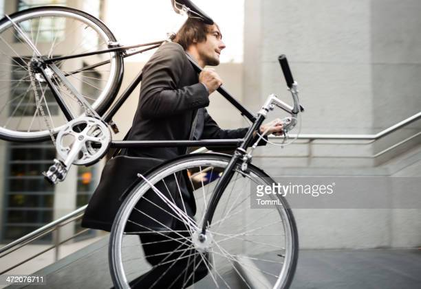 Businessman with Bicycle on Escalator