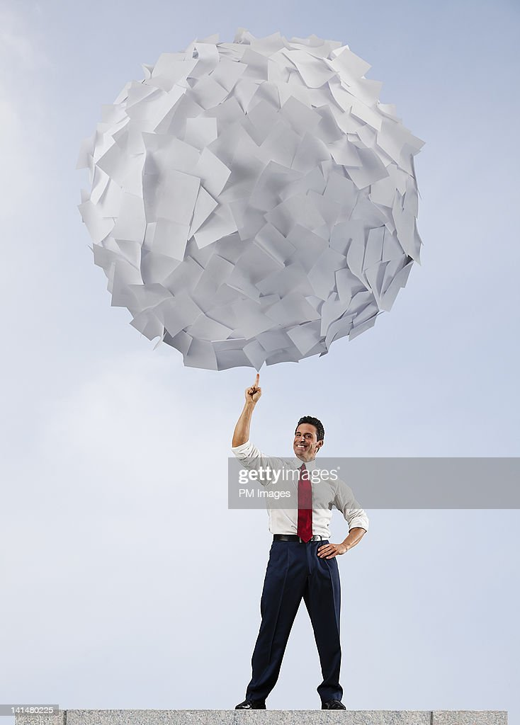 Businessman with big ball of paper : Stock Photo