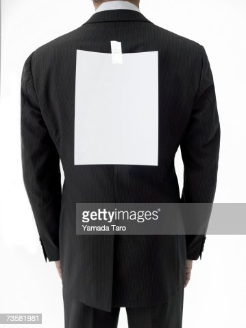 Businessman with blank sheet of paper on back, mid section, rear view