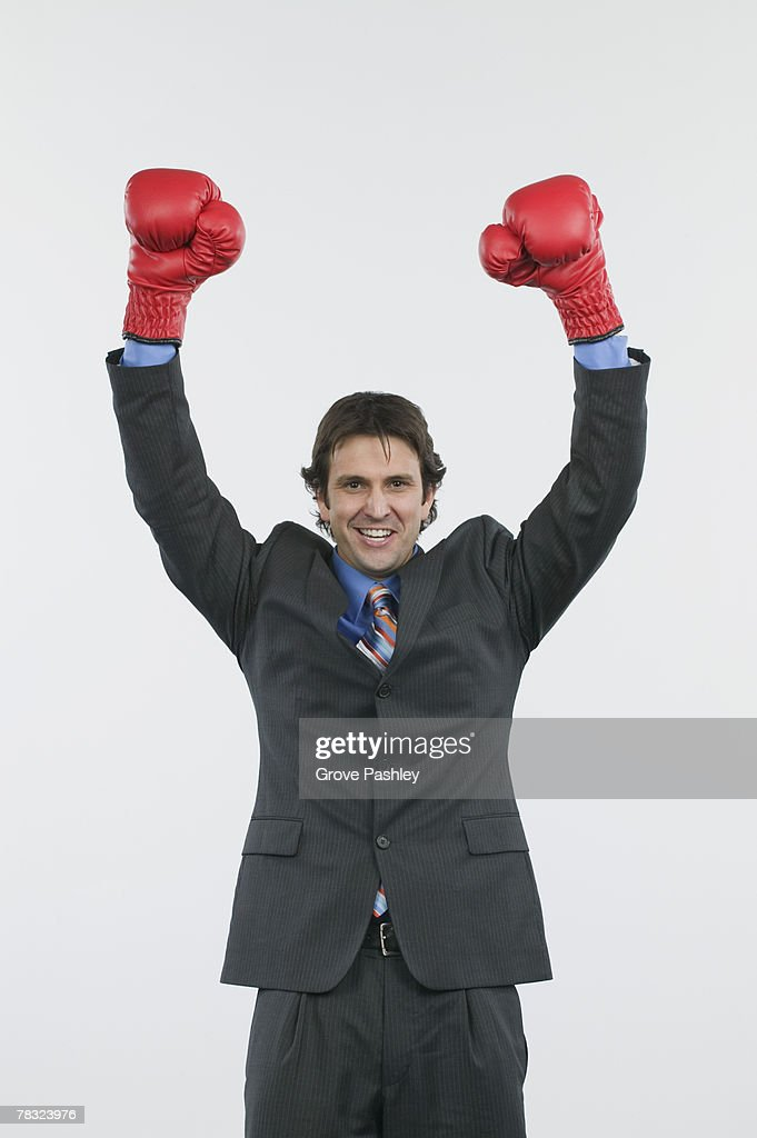 Businessman with boxing gloves : Stock Photo