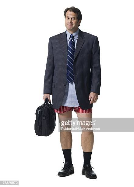 Businessman with briefcase in boxers