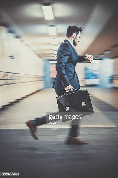 Businessman with briefcase running  late for a meeting