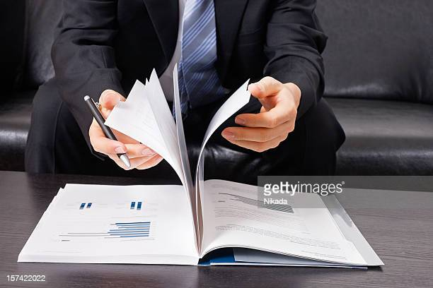 Businessman with business report and pen