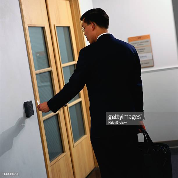 Businessman With Cardkey at Card Reader