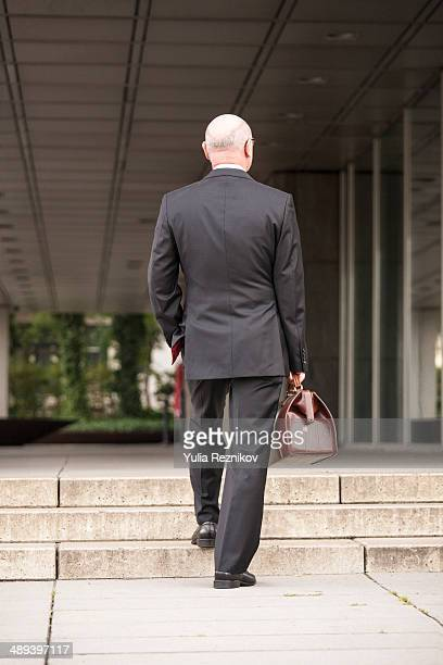 Businessman with case in the morning going to work