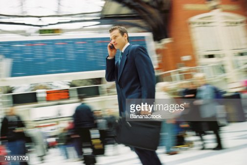 Businessman with cell phone : Stock Photo