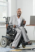 Businessman suffering from Cerebral Palsy using a laptop with his feet