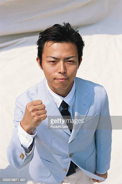 Businessman with clenching fist, portrait