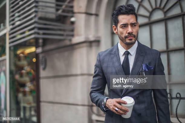 Businessman with coffee to go