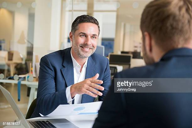 Businessman with colleague in meeting