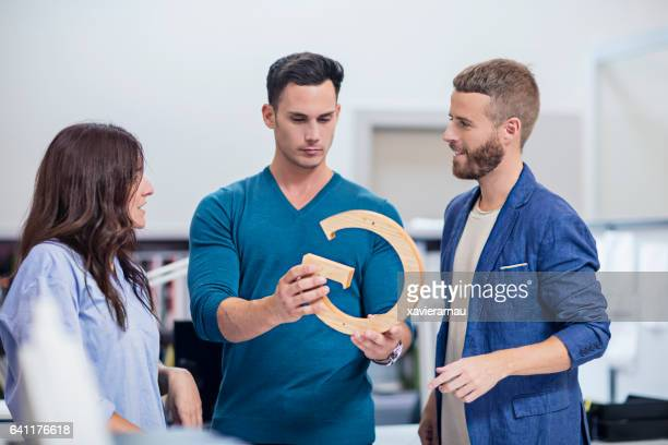 Businessman with colleagues discussing over model