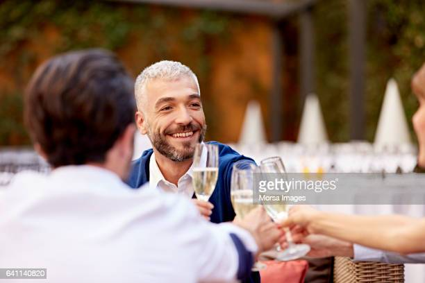 Businessman with colleagues toasting champagne