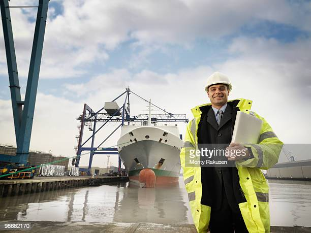 Businessman With Container Ship At Port