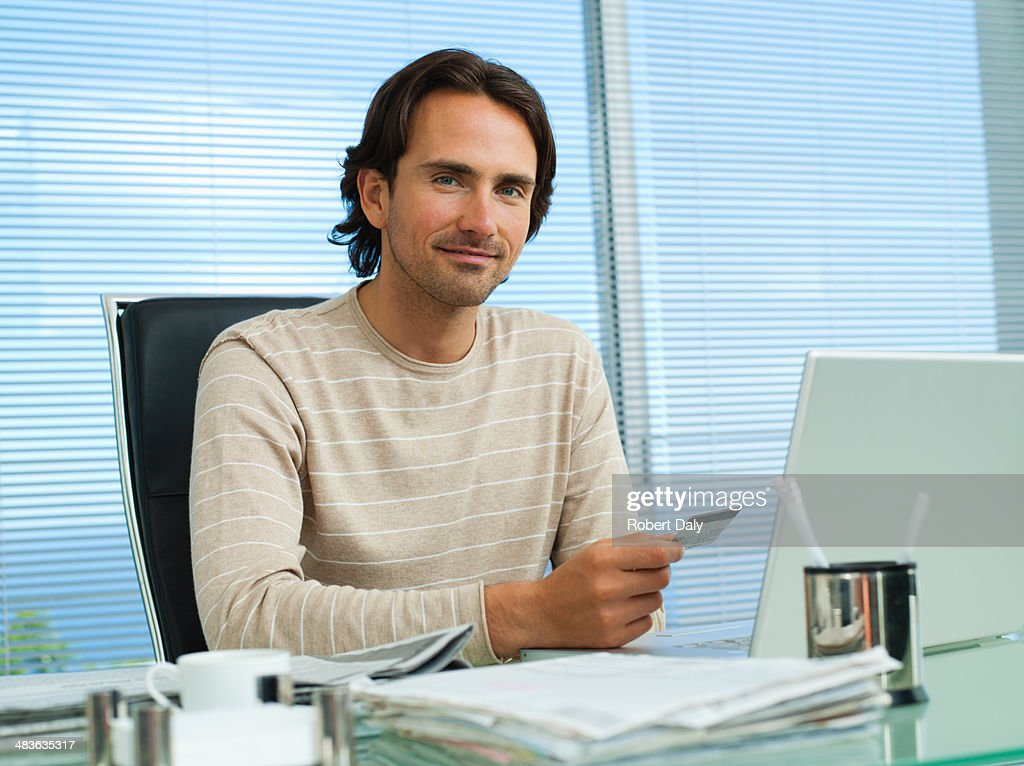 Businessman with credit card and computer : Stock Photo