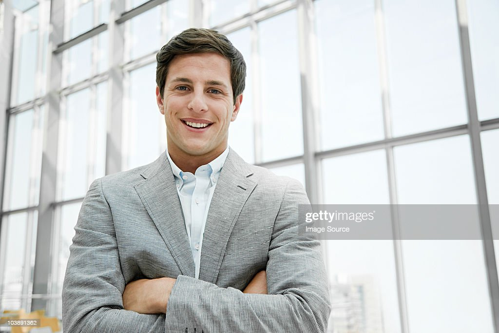 Businessman with crossed arms : Stock Photo