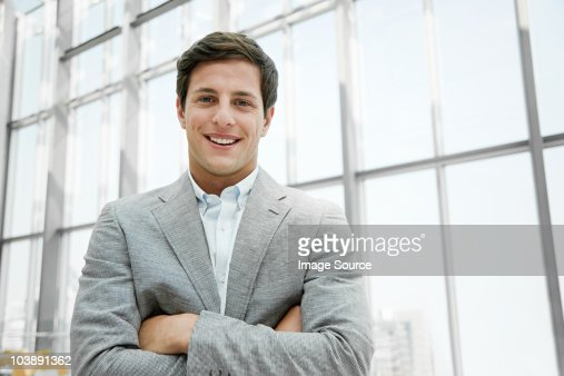 Businessman with crossed arms : Stockfoto
